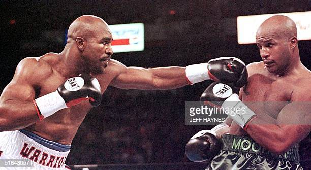 Evander Holyfield punches Michael Moore in the first round of their WBA/IBF Heavyweight Championship Unification fight 08 November at the Thomas Mack...