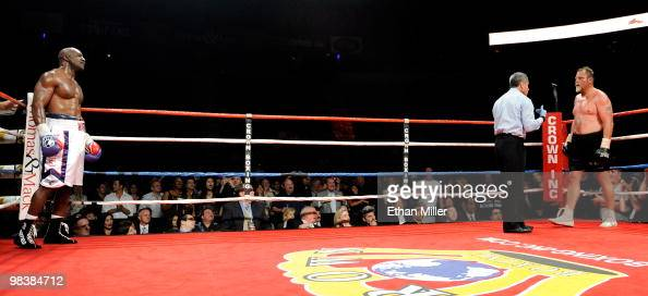 Evander Holyfield stands in a neutral corner as referee Russell Mora gives a count to Francois Botha after Holyfield knocked him to the canvas in the...