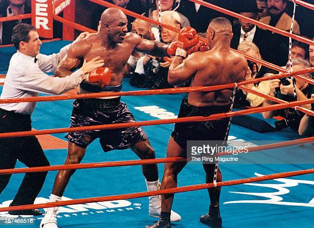 Evander Holyfield throws a left punch against Mike Tyson during the fight at the MGM Grand on November 91996 in Las Vegas Nevada Evander Holyfield...