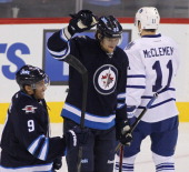 Evander Kane and Nik Antropov of the Winnipeg Jets celebrate Antropov's goal against James Reimer of the Toronto Maple Leafs during first period...