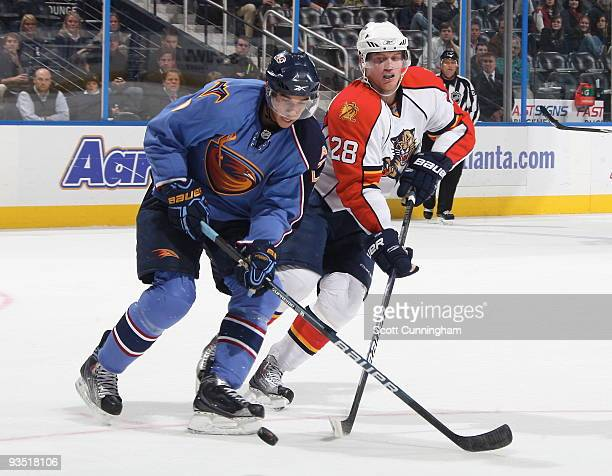 Evander Kane of the Atlanta Thrashers battles for the puck against Kamil Kreps of the Florida Panthers at Philips Arena on November 30 2009 in...