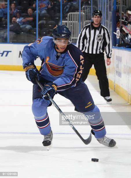 Evander Kane of the Atlanta Thrashers carries the puck during the preseason game against the Nashville Predators at Philips Arena on September 23...