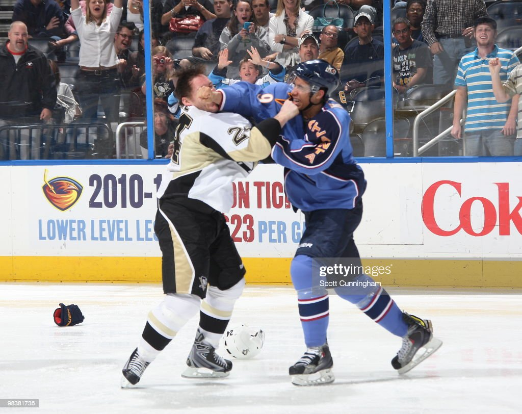 Evander Kane of the Atlanta Thrashers fights against Matt Cooke of the Pittsburgh Penguins at Philips Arena on April 10 2010 in Atlanta Georgia