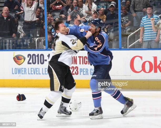 Evander Kane of the Atlanta Thrashers fights against Matt Cooke of the Pittsburgh Penguins at Philips Arena on April 10 2010 in Atlanta Georgia
