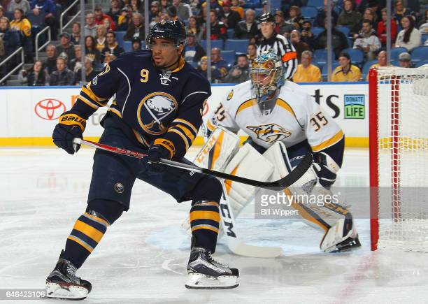 Evander Kane of the Buffalo Sabres and Pekka Rinne of the Nashville Predators watch the play during an NHL game at the KeyBank Center on February 28...