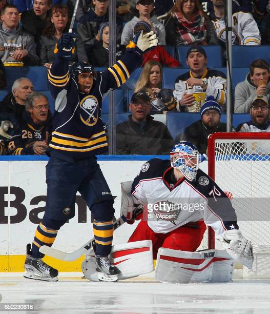 Evander Kane of the Buffalo Sabres celebrates a second period goal by Jake McCabe against Joonas Korpisalo of the Columbus Blue Jackets during an NHL...