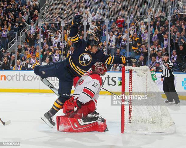 Evander Kane of the Buffalo Sabres celebrates his third period goal against Scott Darling of the Carolina Hurricanes during an NHL game on November...