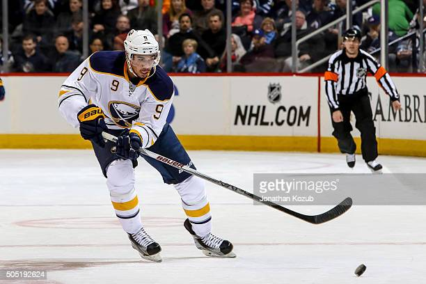 Evander Kane of the Buffalo Sabres chases the puck down the ice during first period action against the Winnipeg Jets at the MTS Centre on January 10...