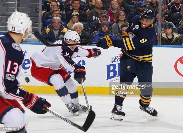 Evander Kane of the Buffalo Sabres follows through on a shot against Zach Werenski of the Columbus Blue Jackets during an NHL game on November 20...