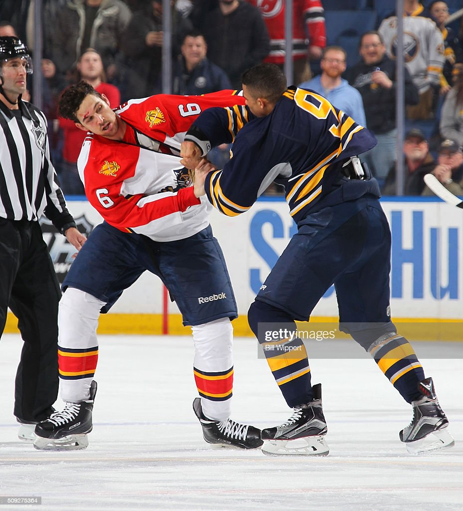 <a gi-track='captionPersonalityLinkClicked' href=/galleries/search?phrase=Evander+Kane&family=editorial&specificpeople=4303789 ng-click='$event.stopPropagation()'>Evander Kane</a> #9 of the Buffalo Sabres has a third period fight against <a gi-track='captionPersonalityLinkClicked' href=/galleries/search?phrase=Alex+Petrovic&family=editorial&specificpeople=8639704 ng-click='$event.stopPropagation()'>Alex Petrovic</a> #6 of the Florida Panthers during an NHL game on February 9, 2016 at the First Niagara Center in Buffalo, New York. Florida won, 7-4.