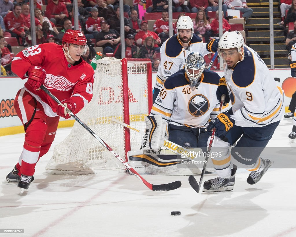 Evander Kane #9 of the Buffalo Sabres reaches for the puck in front of teammate goaltender Robin Lehner #40 as Tomas Nosek #83 of the Detroit Red Wings comes around the net during an NHL game at Joe Louis Arena on March 20, 2017 in Detroit, Michigan. The Sabres defeated the Wings 2-1.
