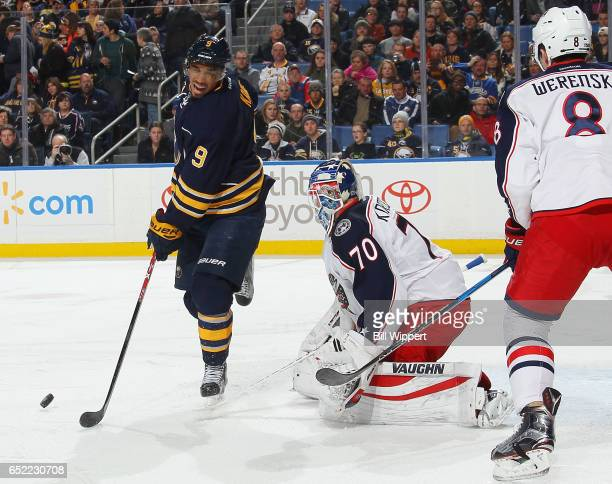 Evander Kane of the Buffalo Sabres reacts after being hit with the puck while screening Joonas Korpisalo of the Columbus Blue Jackets during an NHL...
