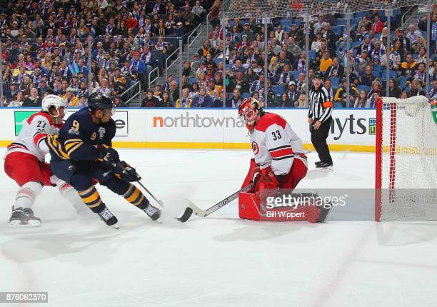 Evander Kane of the Buffalo Sabres scores a third period goal against Scott Darling of the Carolina Hurricanes during an NHL game on November 18 2017...