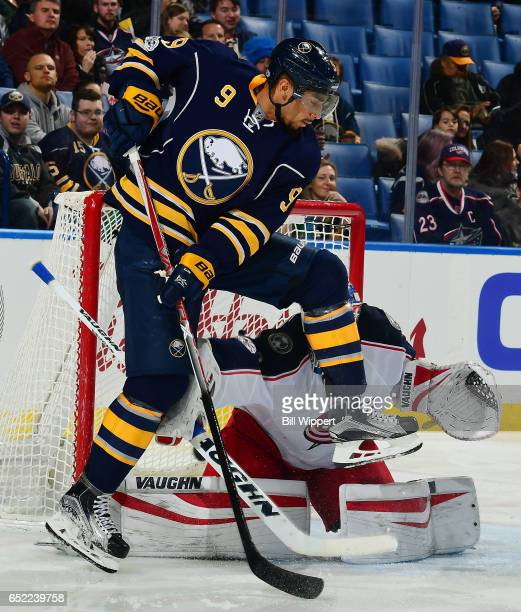 Evander Kane of the Buffalo Sabres screens Joonas Korpisalo of the Columbus Blue Jackets as Jake McCabe scores a second period goal during an NHL...