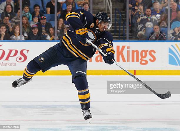 Evander Kane of the Buffalo Sabres shoots the puck against the Columbus Blue Jackets on October 12 2015 at the First Niagara Center in Buffalo New...