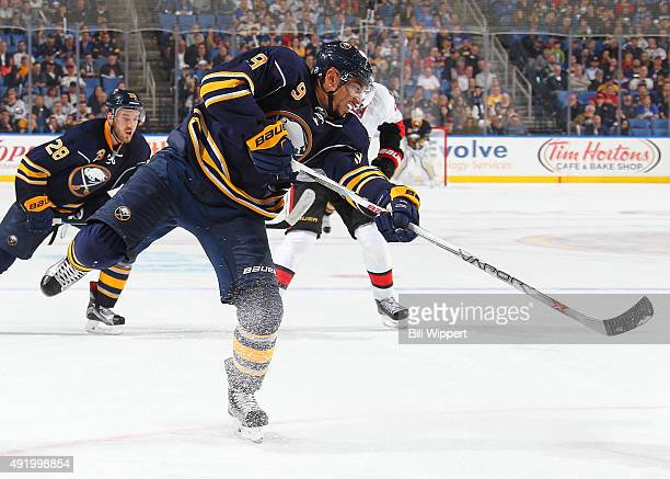 Evander Kane of the Buffalo Sabres shoots the puck against the Ottawa Senators on October 8 2015 at the First Niagara Center in Buffalo New York
