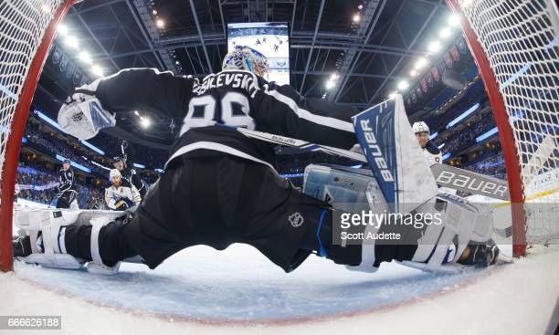 Evander Kane of the Buffalo Sabres shoots the puck for a goal against goalie Andrei Vasilevskiy of the Tampa Bay Lightning during third period at...