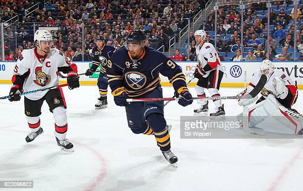 Evander Kane of the Buffalo Sabres skates against Erik Karlsson of the Ottawa Senators during an NHL game at the KeyBank Center on November 9 2016 in...