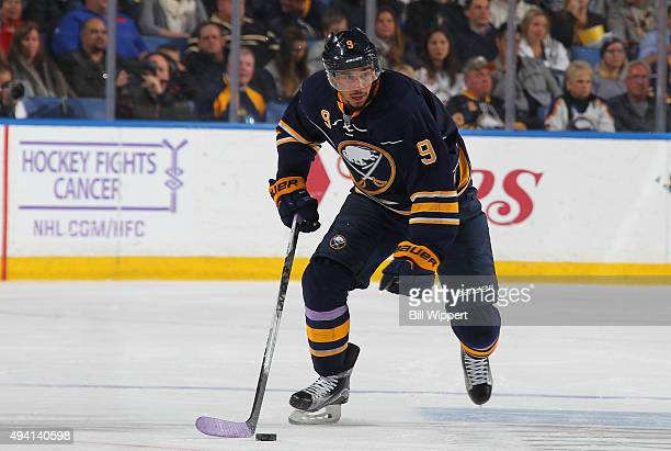 Evander Kane of the Buffalo Sabres skates against the New Jersey Devils during an NHL game on Hockey Fights Cancer night on October 24 2015 at the...