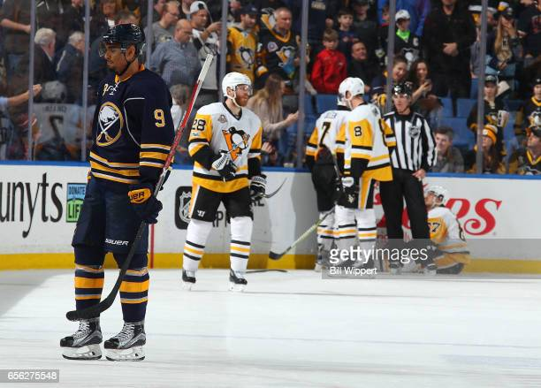 Evander Kane of the Buffalo Sabres skates to the penalty box after highsticking Sidney Crosby of the Pittsburgh Penguins during the third period of...