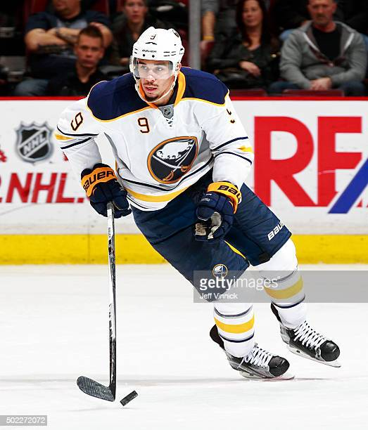 Evander Kane of the Buffalo Sabres skates up ice with the puck during their NHL game against the Vancouver Canucks at Rogers Arena December 7 2015 in...