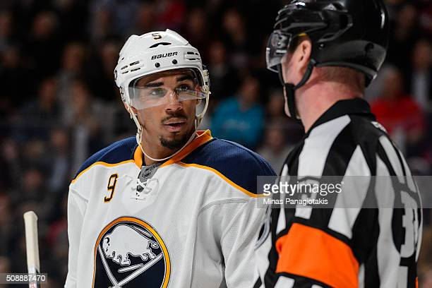 Evander Kane of the Buffalo Sabres speaks with referee Kevin Pollock during the NHL game against the Montreal Canadiens at the Bell Centre on...