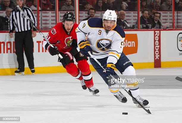 Evander Kane of the Buffalo Sabres stickhandles the puck as he is chased by Mark Stone of the Ottawa Senators at Canadian Tire Centre on January 26...