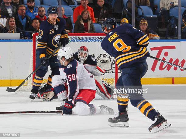 Evander Kane of the Buffalo Sabres takes a third period shot towards David Savard and Sergei Bobrovsky of the Columbus Blue Jackets during an NHL...