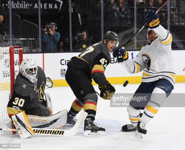 Evander Kane of the Buffalo Sabres tries to get a rebound as Malcolm Subban and Luca Sbisa of the Vegas Golden Knights defend the net in the third...