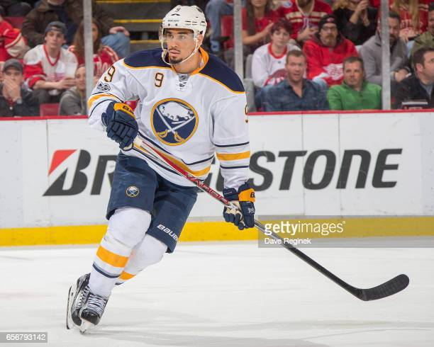 Evander Kane of the Buffalo Sabres turns up ice against the Detroit Red Wings during an NHL game at Joe Louis Arena on March 20 2017 in Detroit...