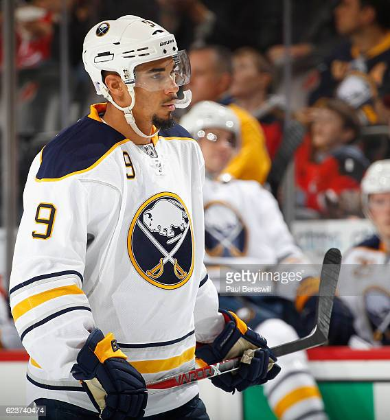 Evander Kane of the Buffalo Sabres waits during an NHL hockey game against the New Jersey Devils at Prudential Center on November 12 2016 in Newark...