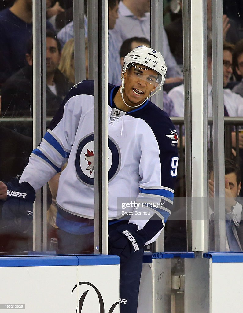 <a gi-track='captionPersonalityLinkClicked' href=/galleries/search?phrase=Evander+Kane&family=editorial&specificpeople=4303789 ng-click='$event.stopPropagation()'>Evander Kane</a> #9 of the Winnipeg Jets argues a two minute penalty for tripping against the New York Rangers with referee Tim Peel #20 (not shown) at Madison Square Garden on April 1, 2013 in New York City. The Rangers defeated the Jets 4-2.