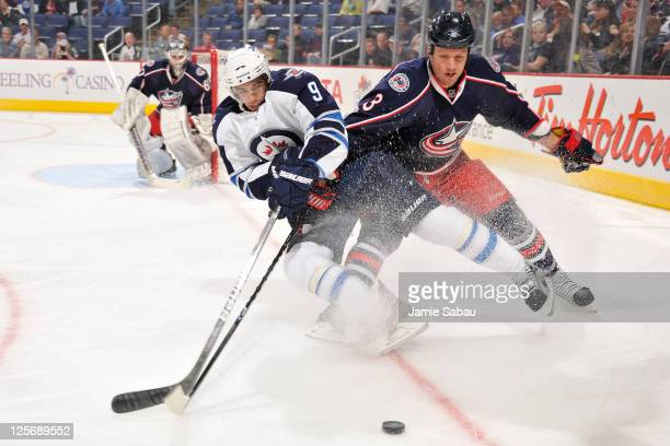 Evander Kane of the Winnipeg Jets battles for control of the puck with Marc Methot of the Columbus Blue Jackets on September 20 2011 at Nationwide...