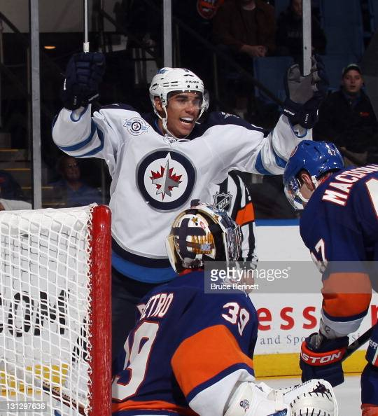 Evander Kane of the Winnipeg Jets celebrates a goal by Johnny Oduya at 1604 of the third period against Rick DiPietro of the New York Islanders at...