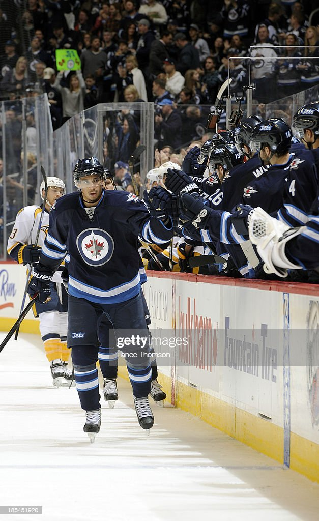 <a gi-track='captionPersonalityLinkClicked' href=/galleries/search?phrase=Evander+Kane&family=editorial&specificpeople=4303789 ng-click='$event.stopPropagation()'>Evander Kane</a> #9 of the Winnipeg Jets celebrates a third period goal against the Nashville Predators with teammates at the bench at the MTS Centre on October 20, 2013 in Winnipeg, Manitoba, Canada.