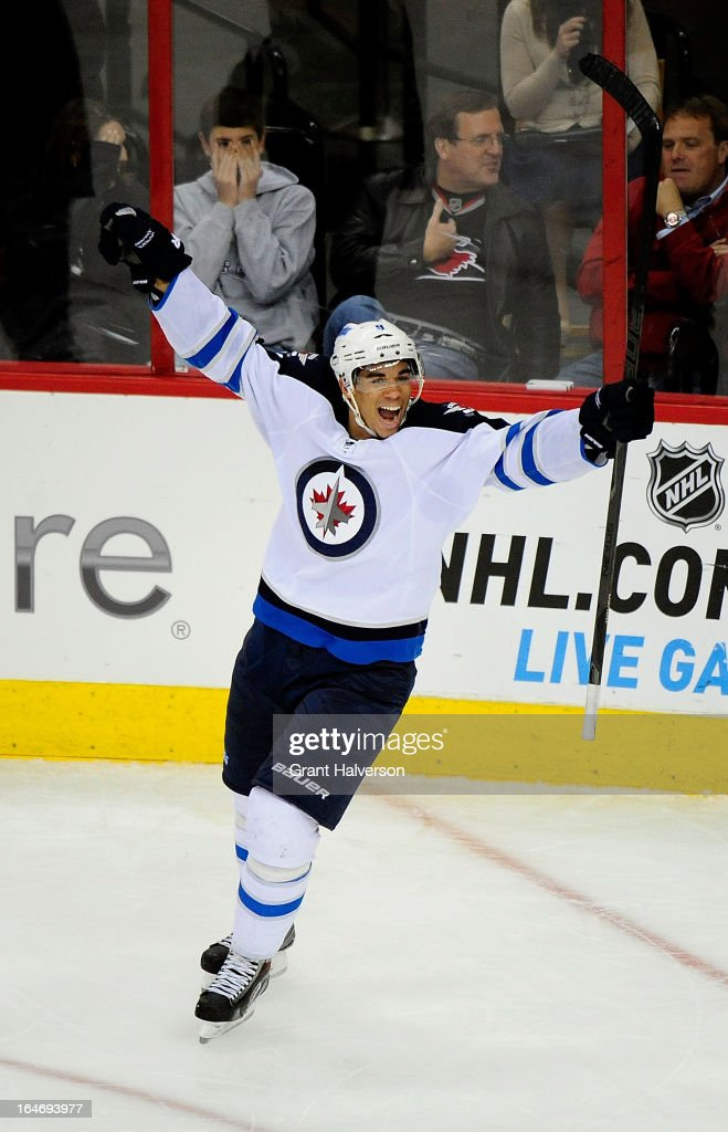 <a gi-track='captionPersonalityLinkClicked' href=/galleries/search?phrase=Evander+Kane&family=editorial&specificpeople=4303789 ng-click='$event.stopPropagation()'>Evander Kane</a> #9 of the Winnipeg Jets celebrates after scoring a goal against the Carolina Hurricanes during the third period at PNC Arena on March 26, 2013 in Raleigh, North Carolina. Winnipeg won 4-1.