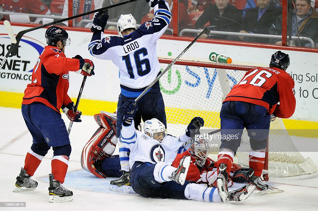 <a gi-track='captionPersonalityLinkClicked' href=/galleries/search?phrase=Evander+Kane&family=editorial&specificpeople=4303789 ng-click='$event.stopPropagation()'>Evander Kane</a> #9 of the Winnipeg Jets celebrates after scoring in the third period against the Washington Capitals at the Verizon Center on February 9, 2012 in Washington, DC. Winnipeg won the game 3-2 in a shootout.