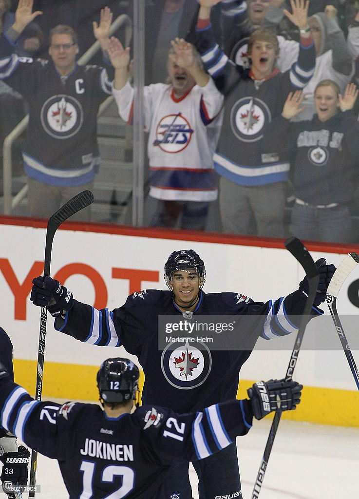 <a gi-track='captionPersonalityLinkClicked' href=/galleries/search?phrase=Evander+Kane&family=editorial&specificpeople=4303789 ng-click='$event.stopPropagation()'>Evander Kane</a> #9 of the Winnipeg Jets celebrates his game winning goal in overtime against the New York Islanders in NHL action on January 27, 2013 at the MTS Centre in Winnipeg, Manitoba, Canada.