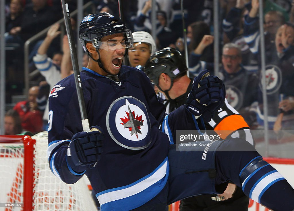 <a gi-track='captionPersonalityLinkClicked' href=/galleries/search?phrase=Evander+Kane&family=editorial&specificpeople=4303789 ng-click='$event.stopPropagation()'>Evander Kane</a> #9 of the Winnipeg Jets celebrates his third period goal against the Nashville Predators at the MTS Centre on October 20, 2013 in Winnipeg, Manitoba, Canada.