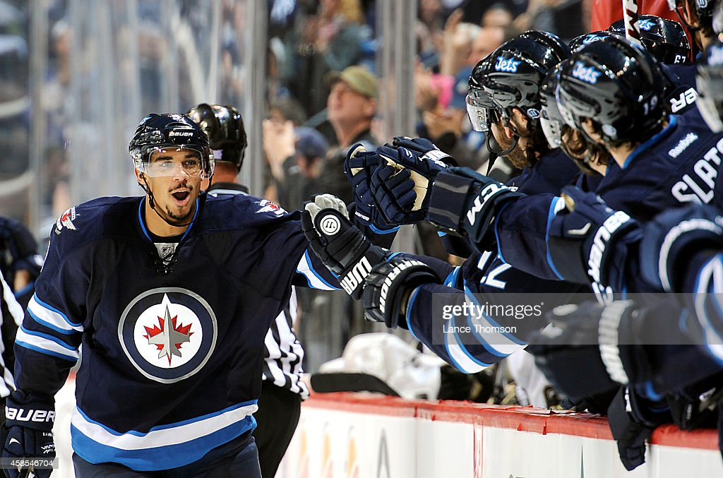 Evander Kane #9 of the Winnipeg Jets celebrates his third period goal against the Pittsburgh Penguins with teammates at the bench on November 6, 2014 at the MTS Centre in Winnipeg, Manitoba, Canada. The goal was the 100th goal of Kane's career.
