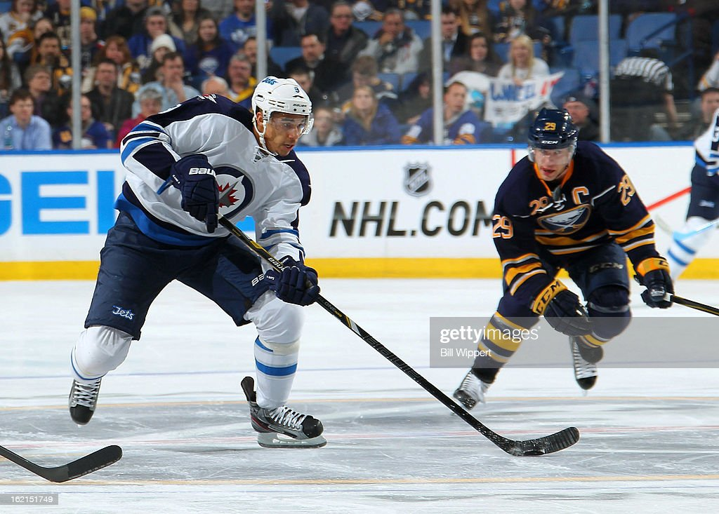 <a gi-track='captionPersonalityLinkClicked' href=/galleries/search?phrase=Evander+Kane&family=editorial&specificpeople=4303789 ng-click='$event.stopPropagation()'>Evander Kane</a> #9 of the Winnipeg Jets controls the puck in front of <a gi-track='captionPersonalityLinkClicked' href=/galleries/search?phrase=Jason+Pominville&family=editorial&specificpeople=570525 ng-click='$event.stopPropagation()'>Jason Pominville</a> #29 of the Buffalo Sabres on February 19, 2013 at the First Niagara Center in Buffalo, New York.