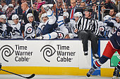 Evander Kane of the Winnipeg Jets falls into his bench after being checked during the second period of a game against the Columbus Blue Jackets on...