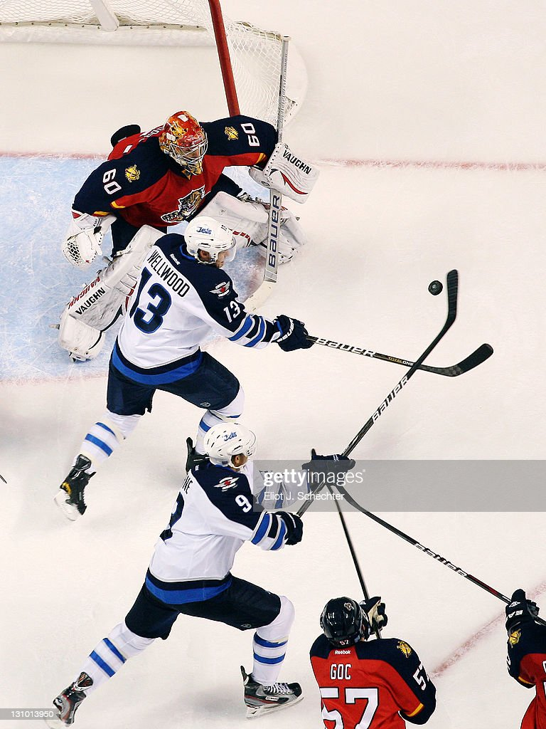 Evander Kane of the Winnipeg Jets knocks the puck in for a goal against Goaltender Jose Theodore of the Florida Panthers at the BankAtlantic Center...