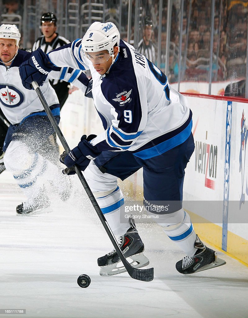 Evander Kane #9 of the Winnipeg Jets moves the puck against the Pittsburgh Penguins on March 28, 2013 at Consol Energy Center in Pittsburgh, Pennsylvania.