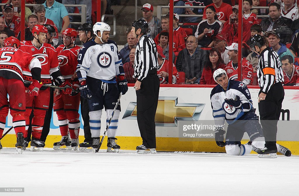 <a gi-track='captionPersonalityLinkClicked' href=/galleries/search?phrase=Evander+Kane&family=editorial&specificpeople=4303789 ng-click='$event.stopPropagation()'>Evander Kane</a> #9 of the Winnipeg Jets pleads his case as he takes a high stick and gets a critical 4 minute power play in the final minutes of an NHL game against the Carolina Hurricanes on March 30, 2012 at PNC Arena in Raleigh, North Carolina.