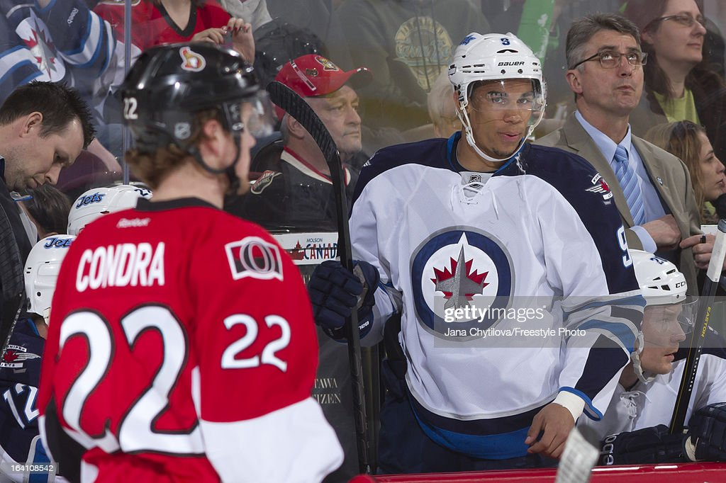 Evander Kane #9 of the Winnipeg Jets prepares to hop enter the game against the Ottawa Senators at Scotiabank Place on March 17, 2013 in Ottawa, Ontario, Canada.