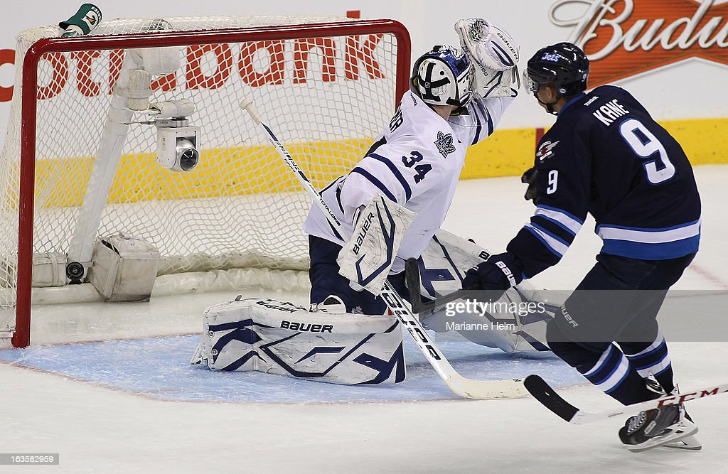 Evander Kane #9 of the Winnipeg Jets scores a goal against James Reimer #34 of the Toronto Maple Leafs during third period action on March 12, 2013 at the MTS Centre in Winnipeg, Manitoba, Canada.