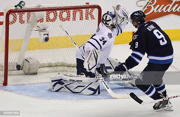 Evander Kane of the Winnipeg Jets scores a goal against James Reimer of the Toronto Maple Leafs during third period action on March 12 2013 at the...