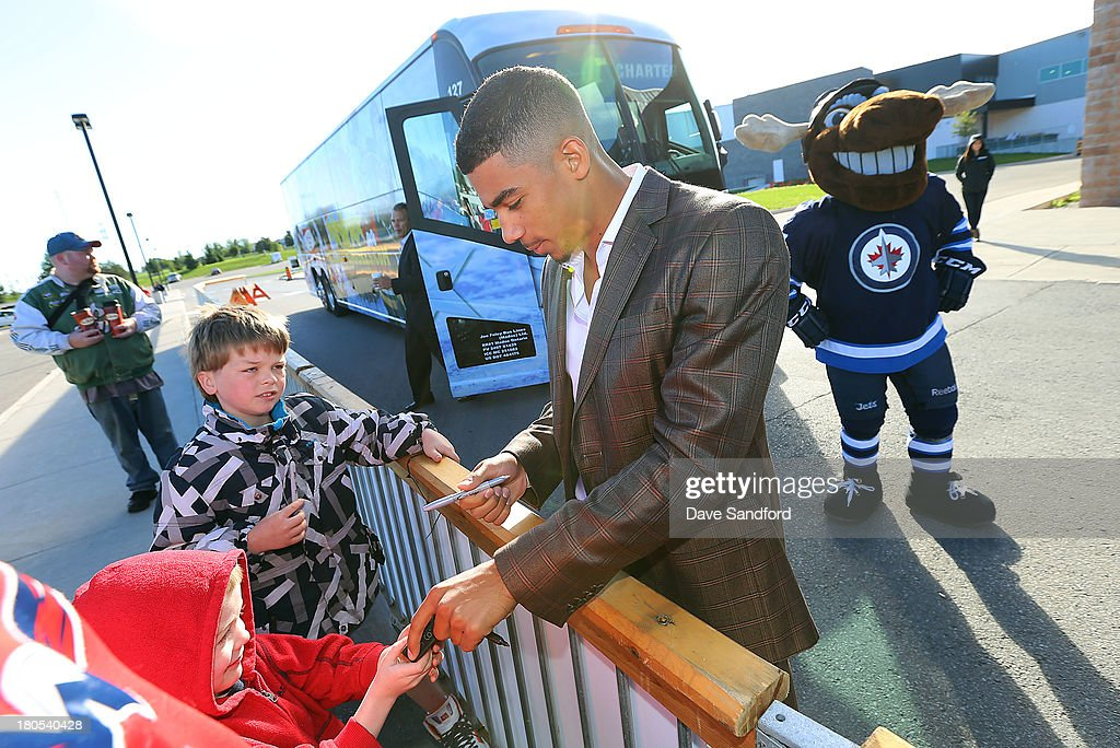 Evander Kane #9 of the Winnipeg Jets signs an autograph for a fan at Yardman arena during Kraft Hockeyville Day 2 on September 14, 2013 in Belleville, Ontario, Canada.