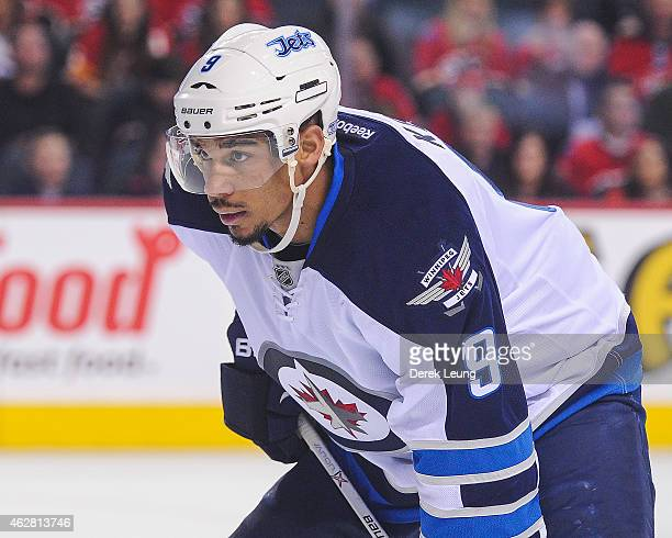 Evander Kane of the Winnipeg Jets skates against the Calgary Flames during an NHL game at Scotiabank Saddledome on February 2 2015 in Calgary Alberta...